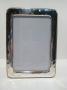 1213 cornice argento 925, ondulata,  foto 10x15
